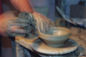Hands on pottery.