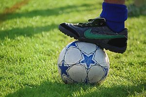Adult Foot on Soccer Ball